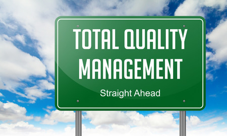 Highway Signpost with Total Quality Management wording on Sky Background, photo