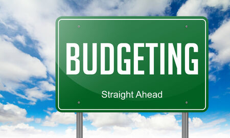 budgeting: Highway Signpost with Budgeting wording on Sky Background