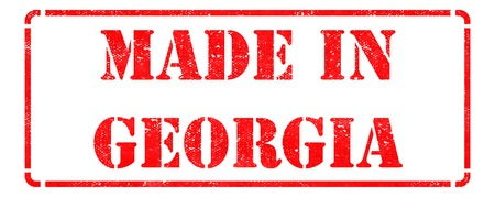 Made in Georgia inscription on Red Rubber Stamp Isolated on White  photo