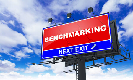 benchmark: Benchmarking Inscription on Red Billboard on Sky Background