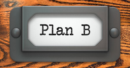 failed plan: Plan B Inscription on File Drawer Label on a Wooden Background