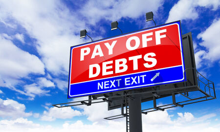 pay off: Pay off Debts - Red Billboard on Sky Background. Business Concept. Stock Photo