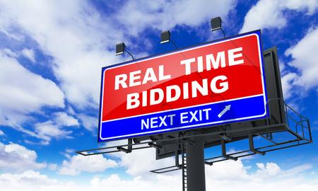 bidding: Real Time Bidding - Red Billboard on Sky Background. Business Concept.