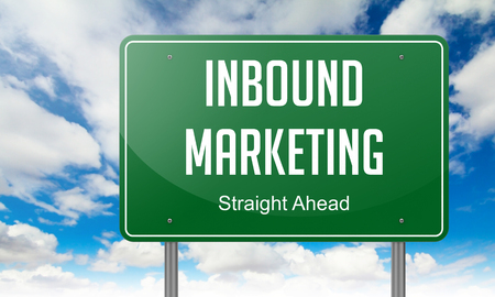 outbound: Highway Signpost with Inbound Marketing wording on Sky Background.