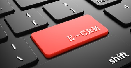 E-CRM on Red Button Enter on Black Computer Keyboard.