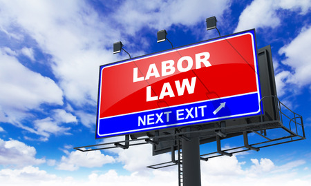 health equity: Labor Law - Red Billboard on Sky Background. Business Concept. Stock Photo