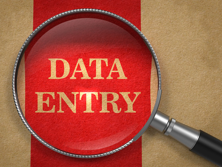 data entry: Data Entry through Magnifying Glass on Old Paper with Red Vertical Line.