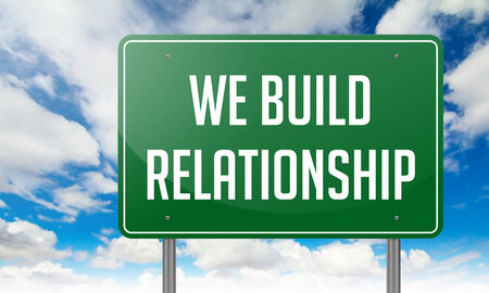 Highway Signpost with We Build Relationship wording on Sky Background. photo
