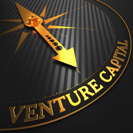 capitalist: Venture Capital - Business Concept. Golden Compass Needle on a Black Field. Stock Photo