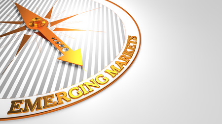 emerging economy: Emerging Markets - Golden Compass Needle on a White Field Pointing. Stock Photo