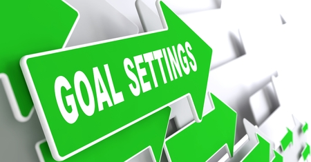 reachable: Goal Settings on Direction Sign - Green Arrow on a Grey Background. Stock Photo