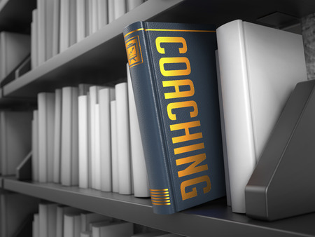 life coaching: Coaching - Grey Book on the Black Bookshelf between white ones. Internet Concept.
