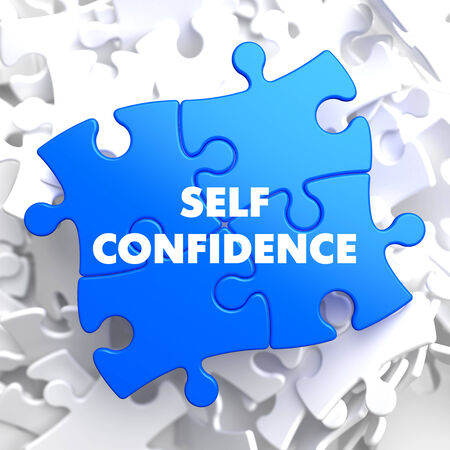 Self Confidence on Blue Puzzle on White Background. photo