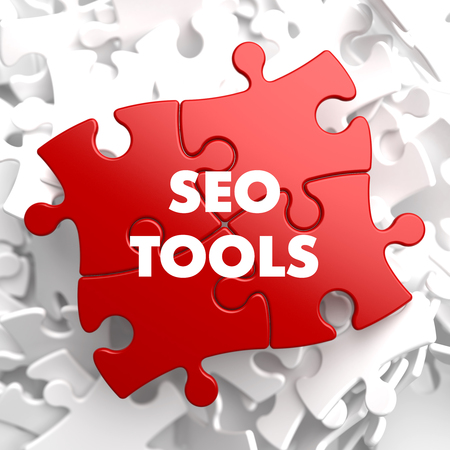 linkbuilding: SEO Tools - Inscription on Red Puzzle on white background.