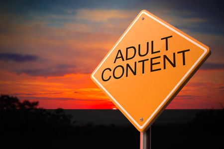 debauch: Adult Content on Warning Road Sign on Sunset Sky Background. Stock Photo