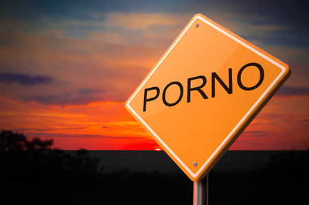 pornography: Porno on Warning Road Sign on Sunset Sky Background.