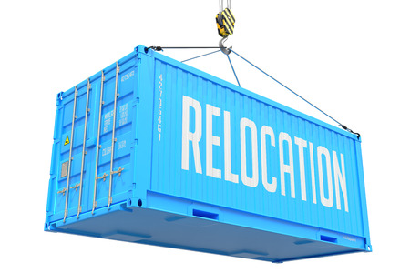 Relocation - Blue Cargo Container hoisted with hook Isolated on White Background. photo
