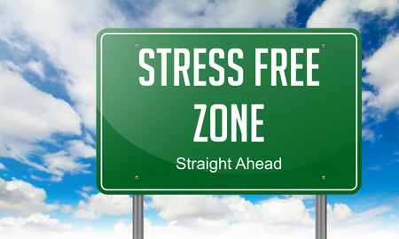 Highway Signpost with Stress Free Zone wording on Sky Background.