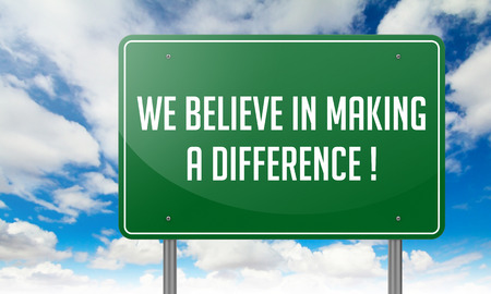 Highway Signpost with We Believe in Making a Difference wording on Sky Background. photo