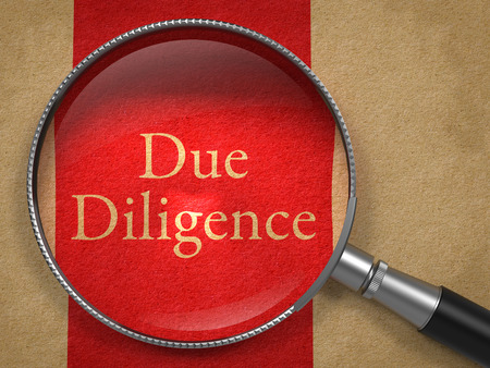 company merger: Due Diligence through Magnifying Glass on Old Paper with Red Vertical Line.