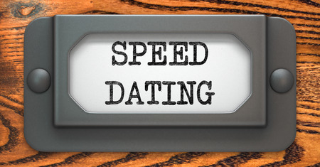 love at first sight: Speed Dating - Inscription on File Drawer Label on a Wooden Background.