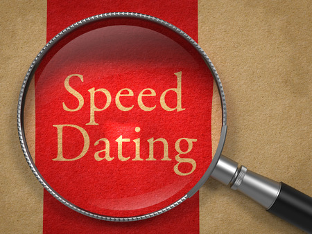 first sight: Speed Dating through Magnifying Glass on Old Paper with Red Vertical Line. Stock Photo