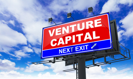 capitalist: Venture Capital - Red Billboard on Sky Background. Business Concept.