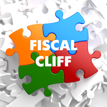 fiscal cliff: Fiscal Cliff on Multicolor Puzzle on White Background. Stock Photo