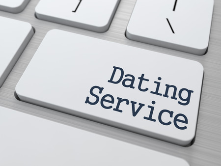 Dating Service Concept. Button on Modern Computer Keyboard. photo