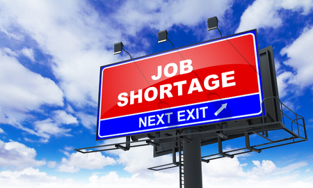 deficit target: Job Shortage - Red Billboard on Sky Background. Business Concept. Stock Photo