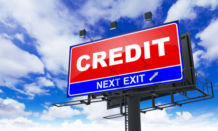 Credit - Red Billboard on Sky Background. Business Concept. photo