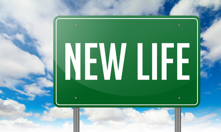 new age: Highway Signpost with New Life wording on Sky Background. Stock Photo