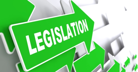 Legislation on Direction Sign - Green Arrow on a Grey Background.
