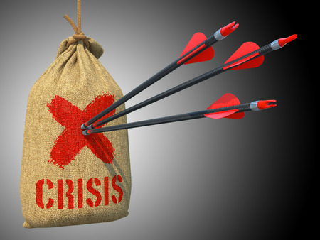 deficit target: Crisis - Three Arrows Hit in Red Target on a Hanging Sack on Grey Background. Stock Photo