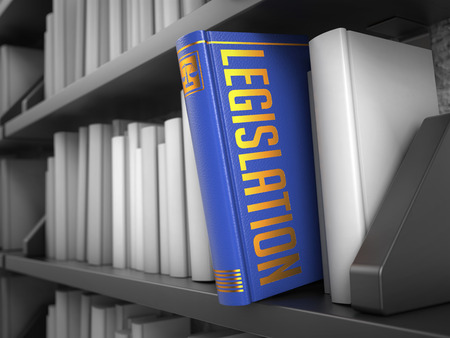 Legislation - Blue Book on the Black Bookshelf between white ones.