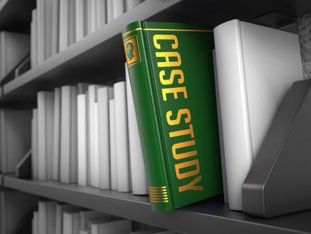 Case Study - Green Book on the Black Bookshelf between white ones. photo