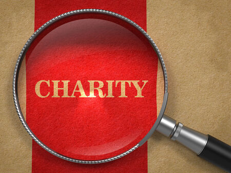 beneficence: Charity through Magnifying Glass on Old Paper with Red Vertical Line.