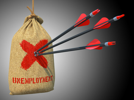Unemployment - Three Arrows Hit in Red Target on a Hanging Sack on Green Bokeh Background. photo