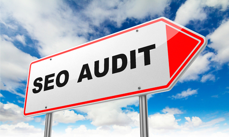 reassessment: Seo Audit - Inscription on Red Road Sign on Sky Background. Stock Photo