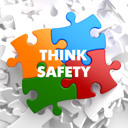 think safety: Think Safety on Multicolor Puzzle on White Background.