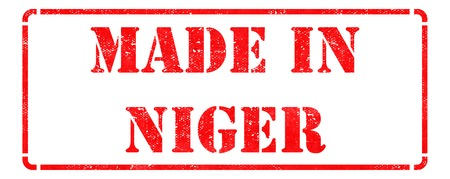 Made in Niger - Inscription on Red Rubber Stamp Isolated on White. photo