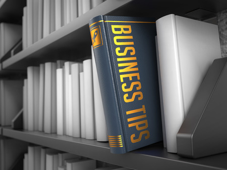 patronage: Business Tips - Grey Book on the Black Bookshelf between white ones.