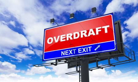 overdraft: Overdraft - Red Billboard on Sky Background. Business Concept.