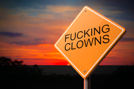 fucking: Fucking Clowns on Warning Road Sign on Sunset Sky Background.