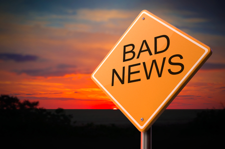 Bad News on Warning Road Sign on Sunset Sky Background.