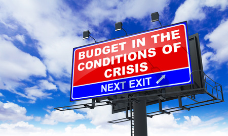critical conditions: Budget in the Conditions of Crisis - Red Billboard on Sky Background. Business Concept.