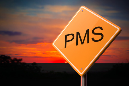 pms: PMS on Warning Road Sign on Sunset Sky Background.
