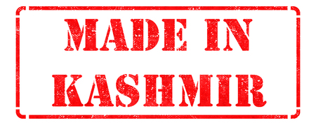 Made in Kashmir - Inscription on Red Rubber Stamp Isolated on White. photo