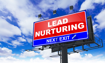 lead: Lead Nurturing - Red Billboard on Sky Background. Business Concept. Stock Photo