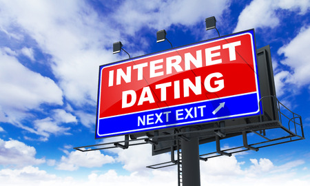 Internet Dating - Red Billboard on Sky Background. Business Concept. photo